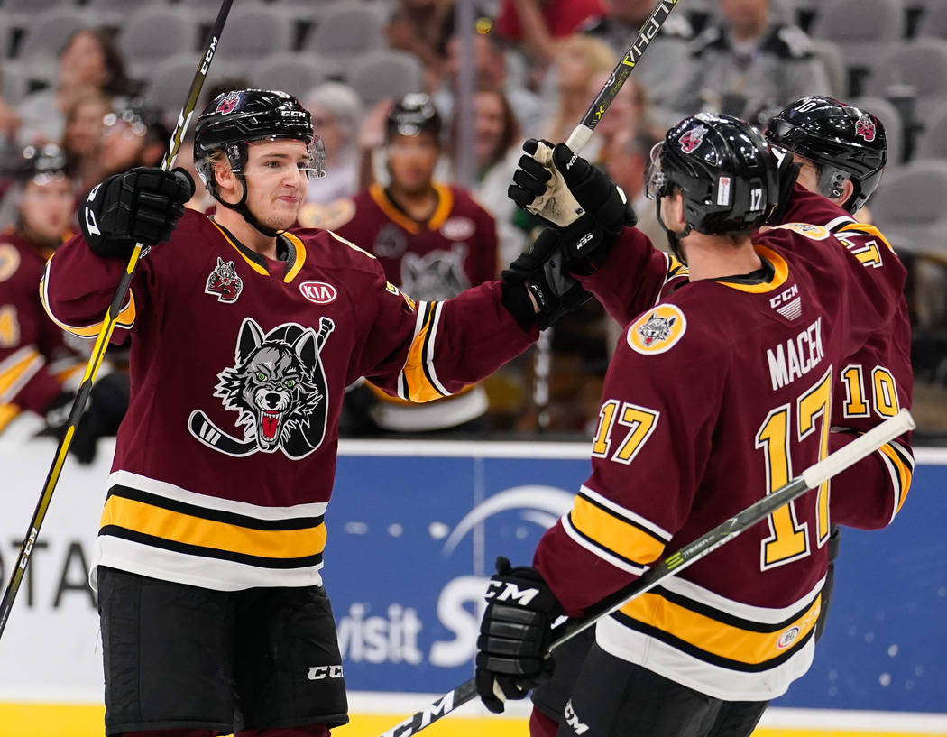 Chicago's Erik Brannstrom, left, celebrates a goal with teammate Brace Macek during an AHL game earlier this season. The Chicago Wolves play the San Antonio Rampage during the third period of an A ...
