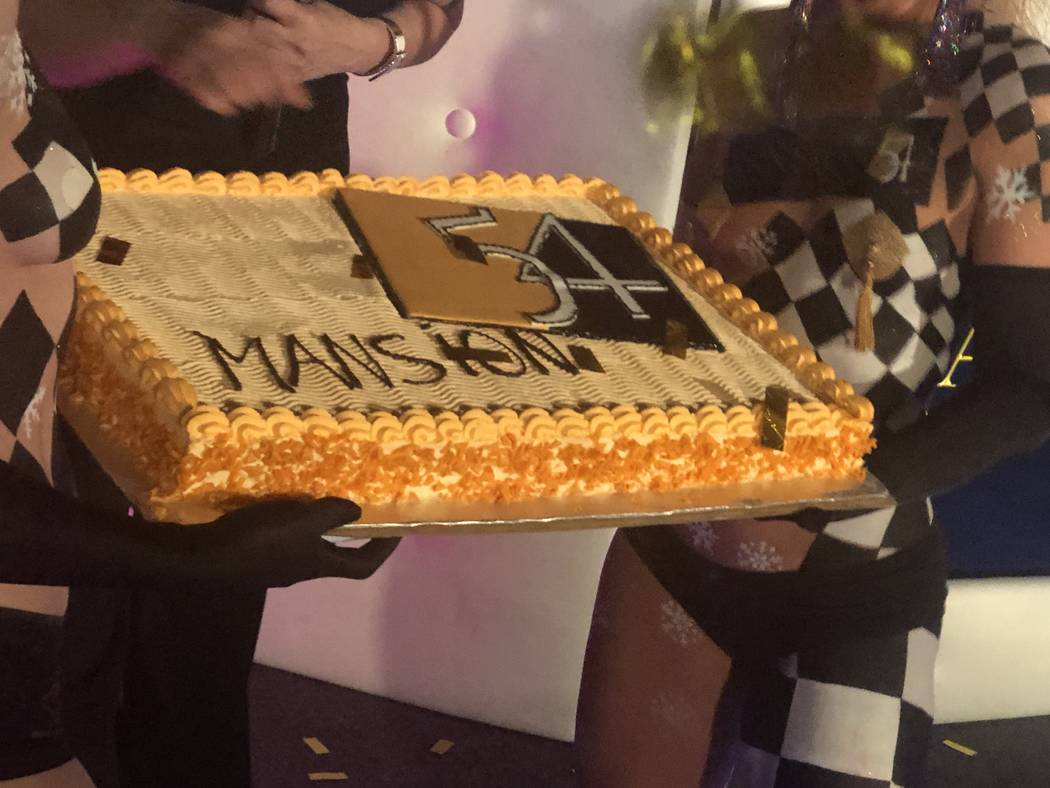 A celebratory cake is shown at Mansion 54's VIP preview party on Friday, Dec. 7, 2018. (John Katsilometes/Las Vegas Review-Journal)