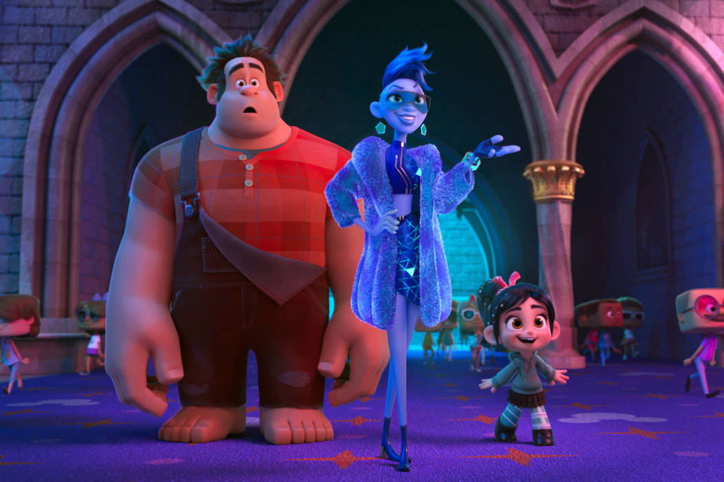 "This image released by Disney shows characters, from left, Ralph, voiced by John C. Reilly, Yess, voiced by Taraji P. Henson and Vanellope von Schweetz, voiced by Sarah Silverman in a scene from "" ..."