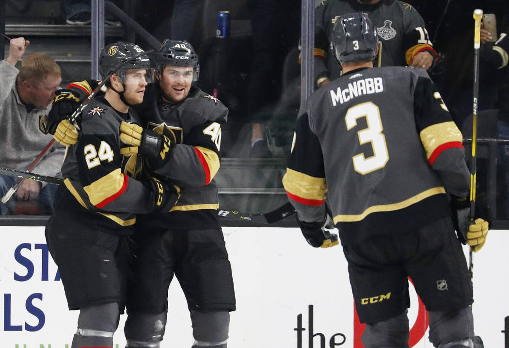 Vegas Golden Knights' Oscar Lindberg (24) celebrates after Ryan Carpenter (40) scored against the Dallas Stars during the first period of an NHL hockey game Sunday, Dec. 9, 2018, in Las Vegas. (AP ...