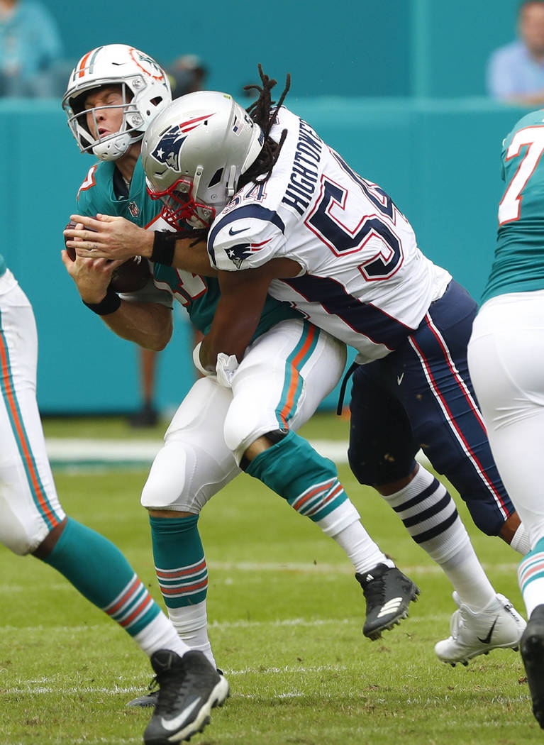 New England Patriots outside linebacker Dont'a Hightower (54) tackles Miami Dolphins quarterback Ryan Tannehill (17), during the first half of an NFL football game, Sunday, Dec. 9, 2018, in Miami ...