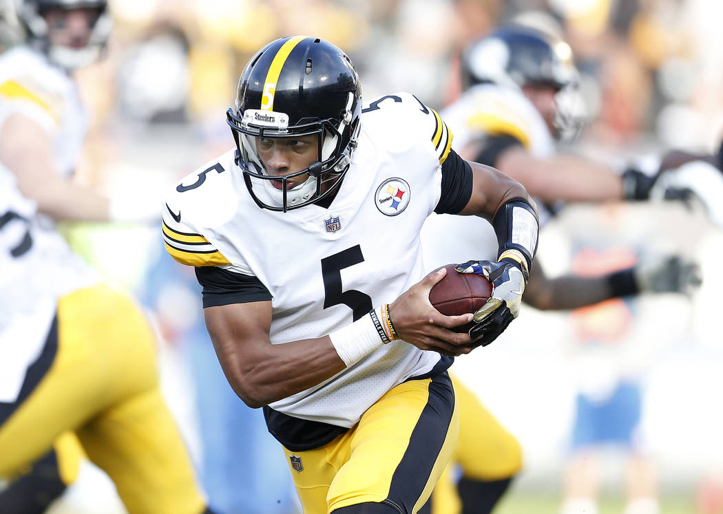 Pittsburgh Steelers quarterback Joshua Dobbs (5) runs against the Oakland Raiders during the second half of an NFL football game in Oakland, Calif., Sunday, Dec. 9, 2018. (AP Photo/D. Ross Cameron)