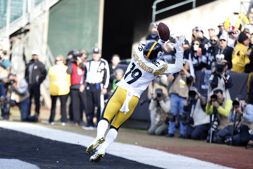 Pittsburgh Steelers wide receiver JuJu Smith-Schuster (19) catches a touchdown pass during the first half of an NFL football game against the Oakland Raiders in Oakland, Calif., Sunday, Dec. 9, 20 ...