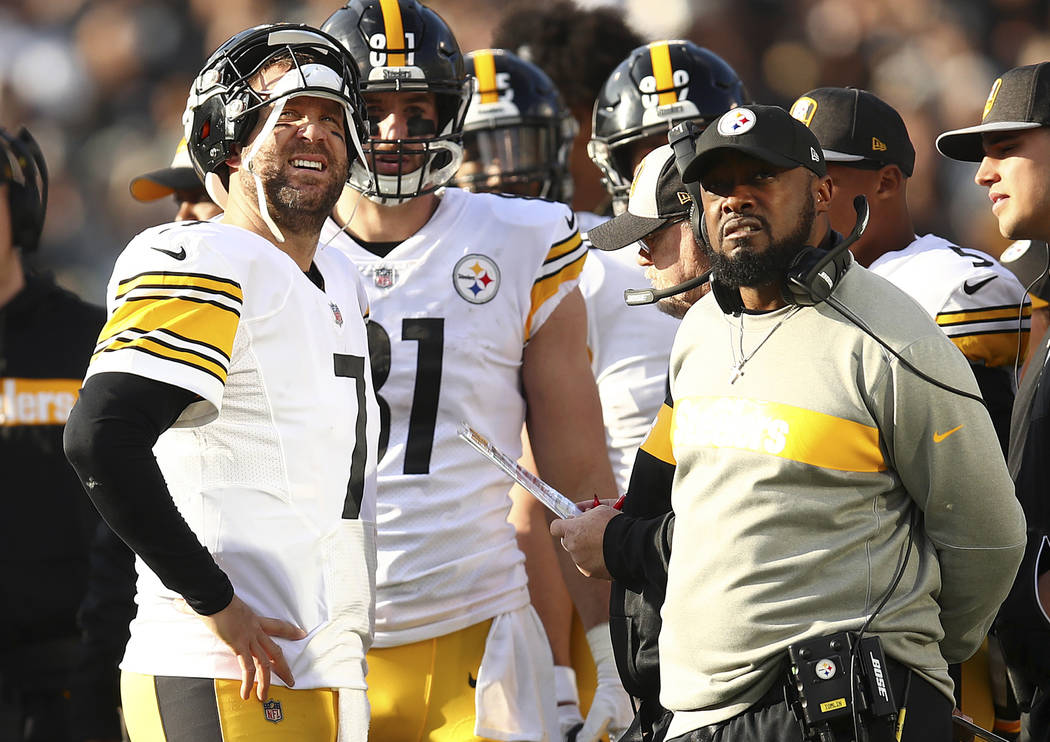 Pittsburgh Steelers quarterback Ben Roethlisberger, left, talks with head coach Mike Tomlin during the first half of an NFL football game against the Oakland Raiders in Oakland, Calif., Sunday, De ...