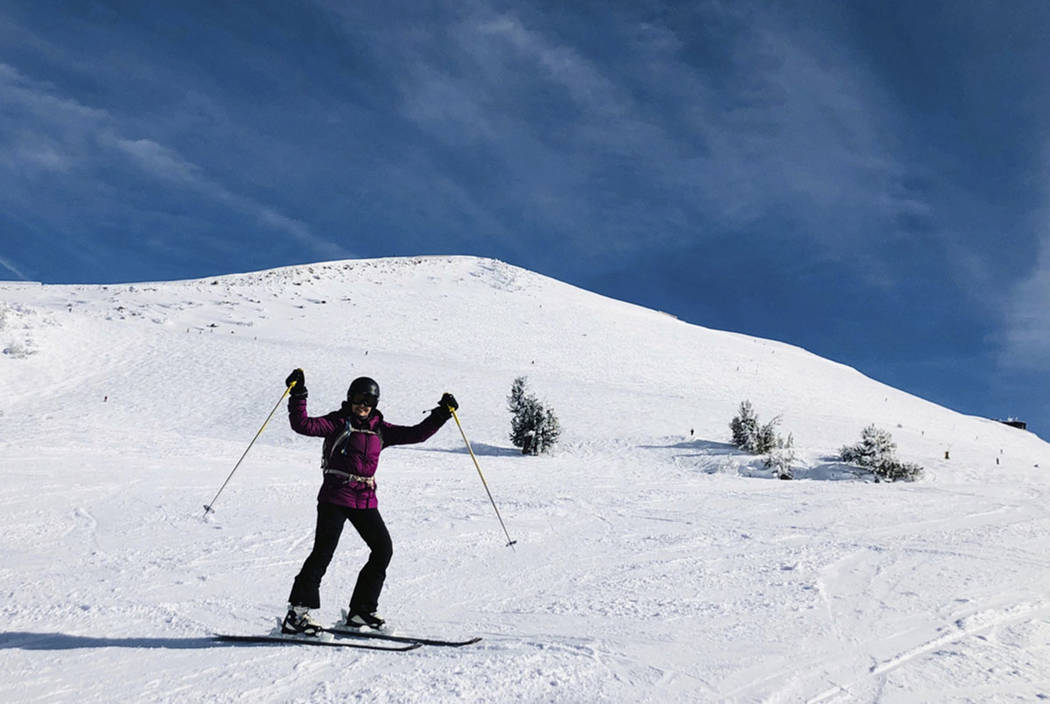 In this Friday, Dec. 7, 2018, a skier poses for a photo at Mammoth Mountain ski resort in Mammoth Lakes, Calif. (AP Photo/Christopher Weber)