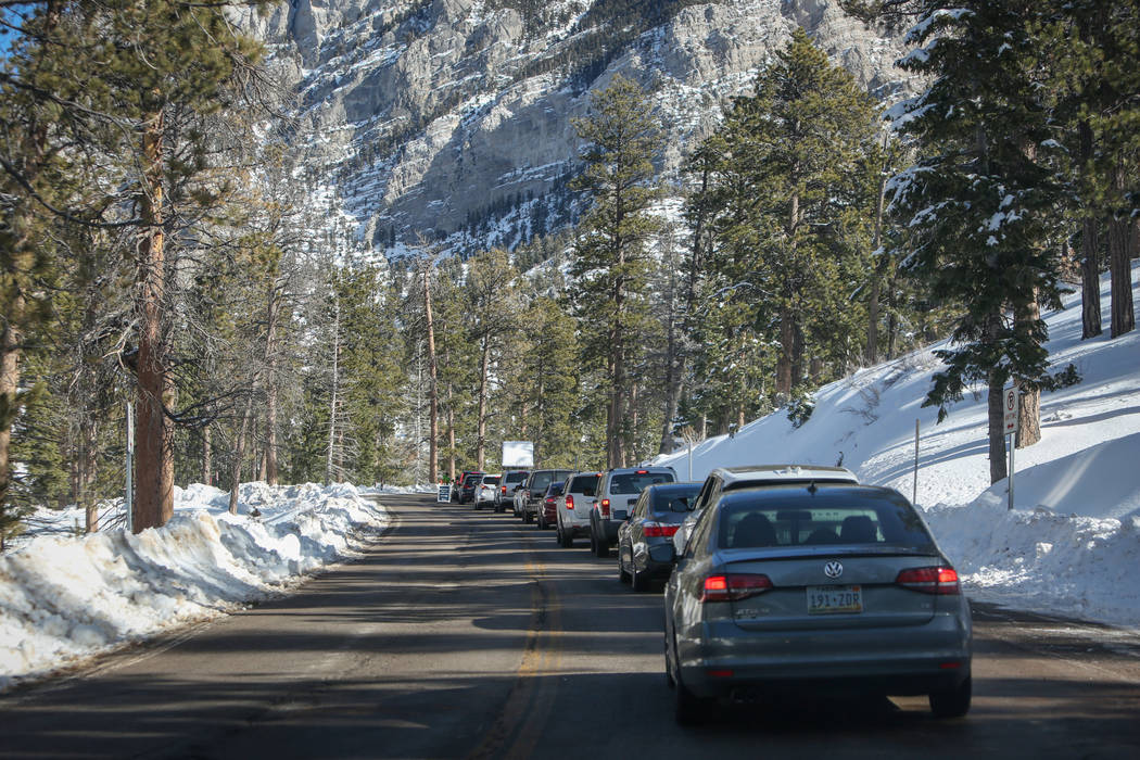 Cars line up waiting to park surrounding the skiing and snowboarding area during the opening weekend for the winter season at Lee Canyon near Las Vegas, Sunday, Dec. 9, 2018. Caroline Brehman/Las ...