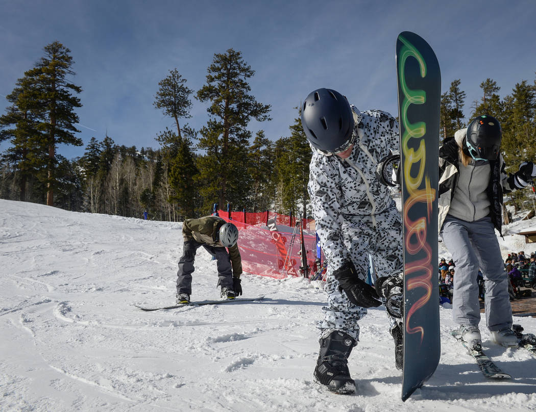 Ben Nethery from Las Vegas picks up his snowboard after going down a trail during the opening weekend for the winter season at Lee Canyon near Las Vegas, Sunday, Dec. 9, 2018. Caroline Brehman/Las ...