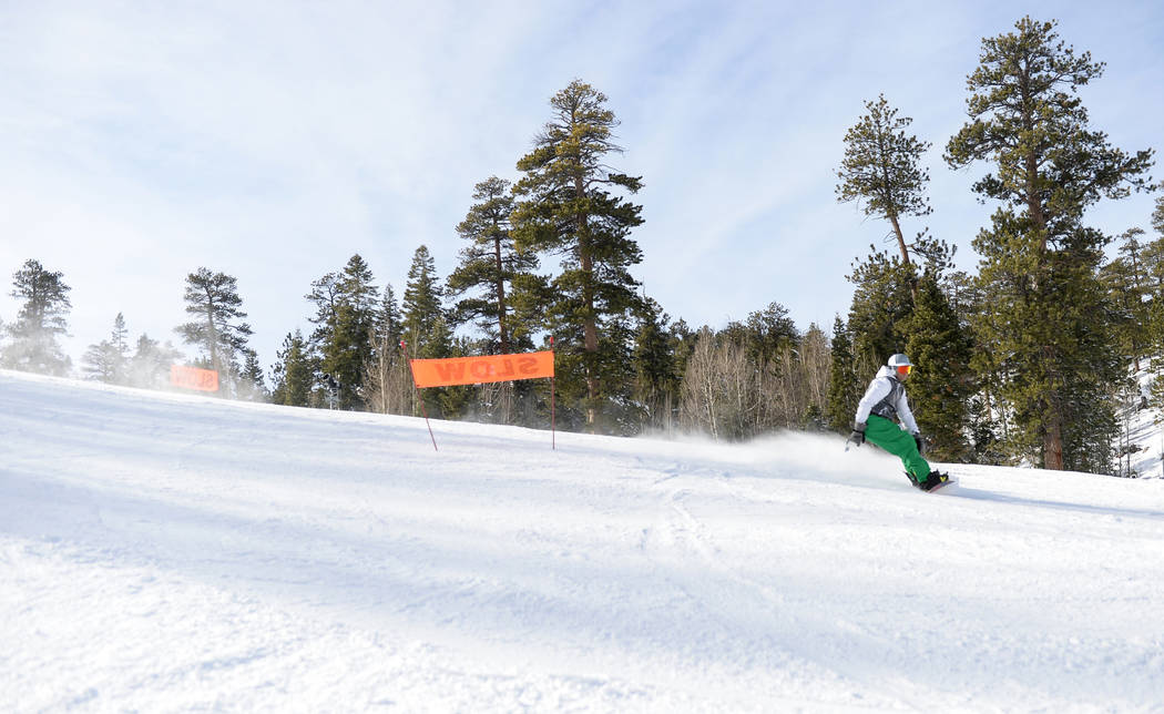 Creighton Adams from Las Vegas snow boards down one of the trails during the opening weekend for the winter season at Lee Canyon near Las Vegas, Sunday, Dec. 9, 2018. Caroline Brehman/Las Vegas Re ...