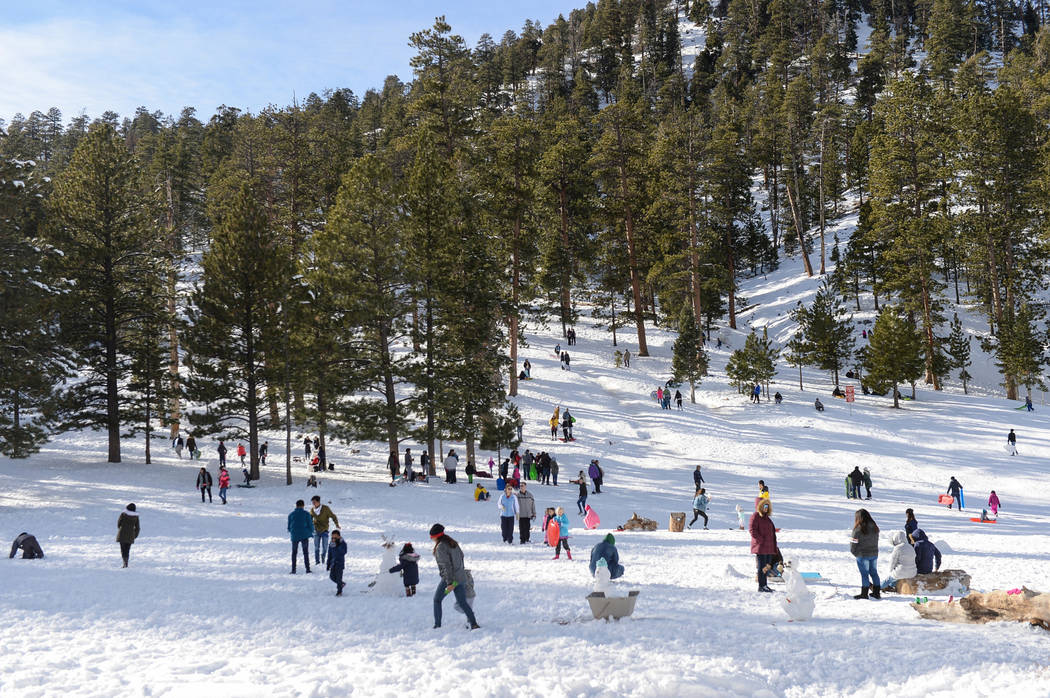 People gather to sled and play in the snow during the opening weekend for the winter season at Lee Canyon near Las Vegas, Sunday, Dec. 9, 2018. Caroline Brehman/Las Vegas Review-Journal