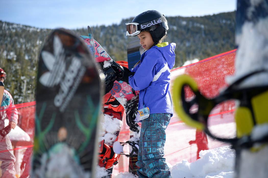 Kirra Jijon, 10, from Las Vegas carries her snowboard during the opening weekend for the winter season at Lee Canyon near Las Vegas, Sunday, Dec. 9, 2018. Caroline Brehman/Las Vegas Review-Journal