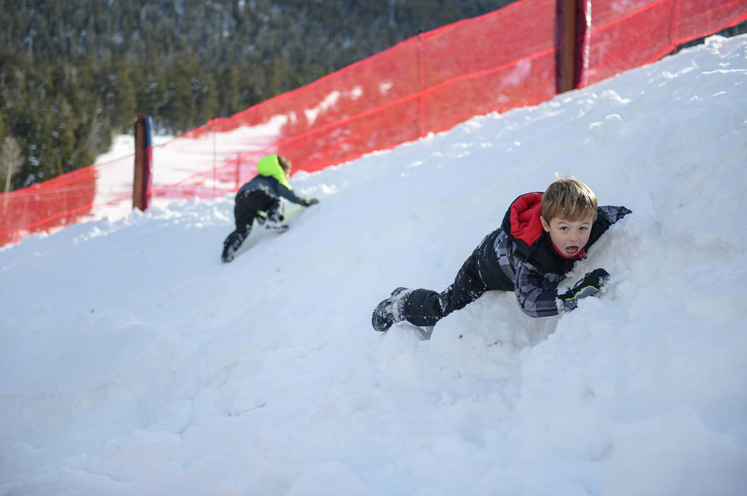 Nicholas Tarantino, 5, from Las Vegas rolls down a snow bank near a rest area during the opening weekend for the winter season at Lee Canyon near Las Vegas, Sunday, Dec. 9, 2018. Caroline Brehman/ ...