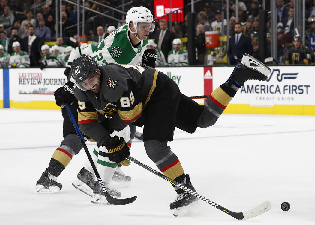 Vegas Golden Knights right wing Alex Tuch (89) vies for the puck with Dallas Stars defenseman Esa Lindell (23) during the second period of an NHL hockey game Sunday, Dec. 9, 2018, in Las Vegas. (A ...