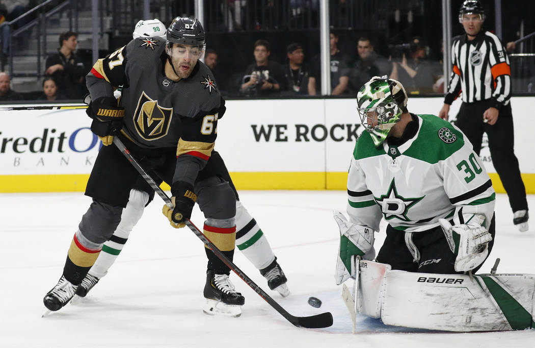 Vegas Golden Knights left wing Max Pacioretty (67) tries to tip the puck past Dallas Stars goaltender Ben Bishop (30) during the second period of an NHL hockey game Sunday, Dec. 9, 2018, in Las Ve ...
