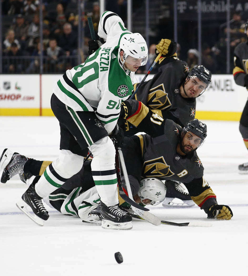 Dallas Stars center Jason Spezza (90) knocks down Vegas Golden Knights center Pierre-Edouard Bellemare (41) during the second period of an NHL hockey game Sunday, Dec. 9, 2018, in Las Vegas. (AP P ...