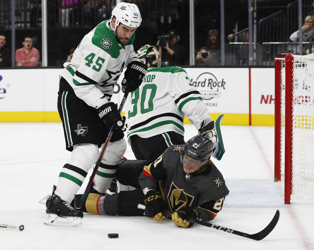 Vegas Golden Knights center Cody Eakin (21) falls after colliding with Dallas Stars goaltender Ben Bishop (30) as defenseman Roman Polak (45) knocks the puck away during the second period of an NH ...