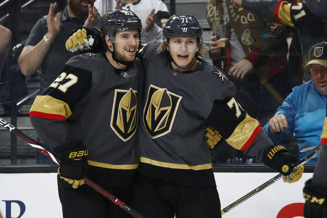 Vegas Golden Knights defenseman Shea Theodore (27) celebrates after Vegas Golden Knights center William Karlsson, right, scored against the Dallas Stars during the second period of an NHL hockey g ...