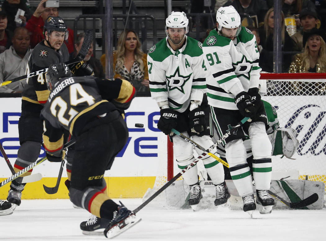 Dallas Stars center Tyler Seguin (91) and right wing Alexander Radulov (47) try to block a shot by Vegas Golden Knights center Oscar Lindberg (24) during the first period of an NHL hockey game Sun ...