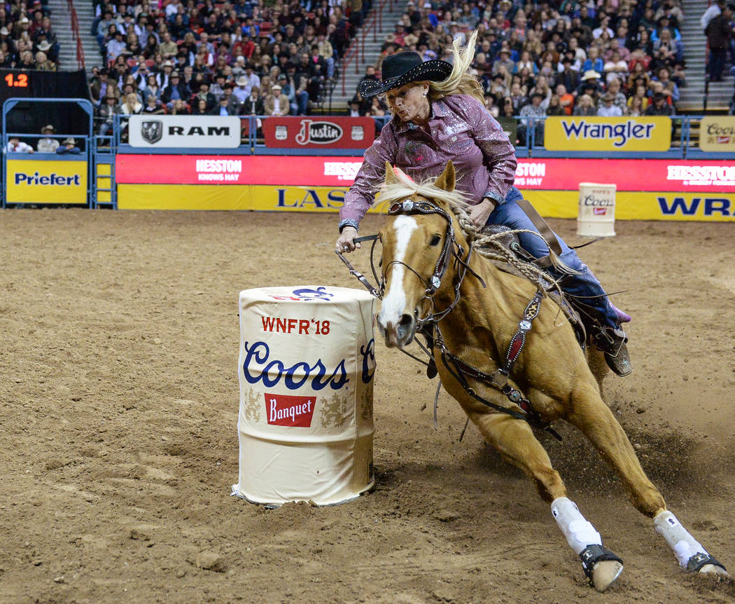 Tammy Fischer, of Ledbetter, Texas, competes in Barrel Racing during the fourth go-round of the National Finals Rodeo at the Thomas & Mack Center in Las Vegas, Sunday, Dec. 9, 2018. Caroline B ...