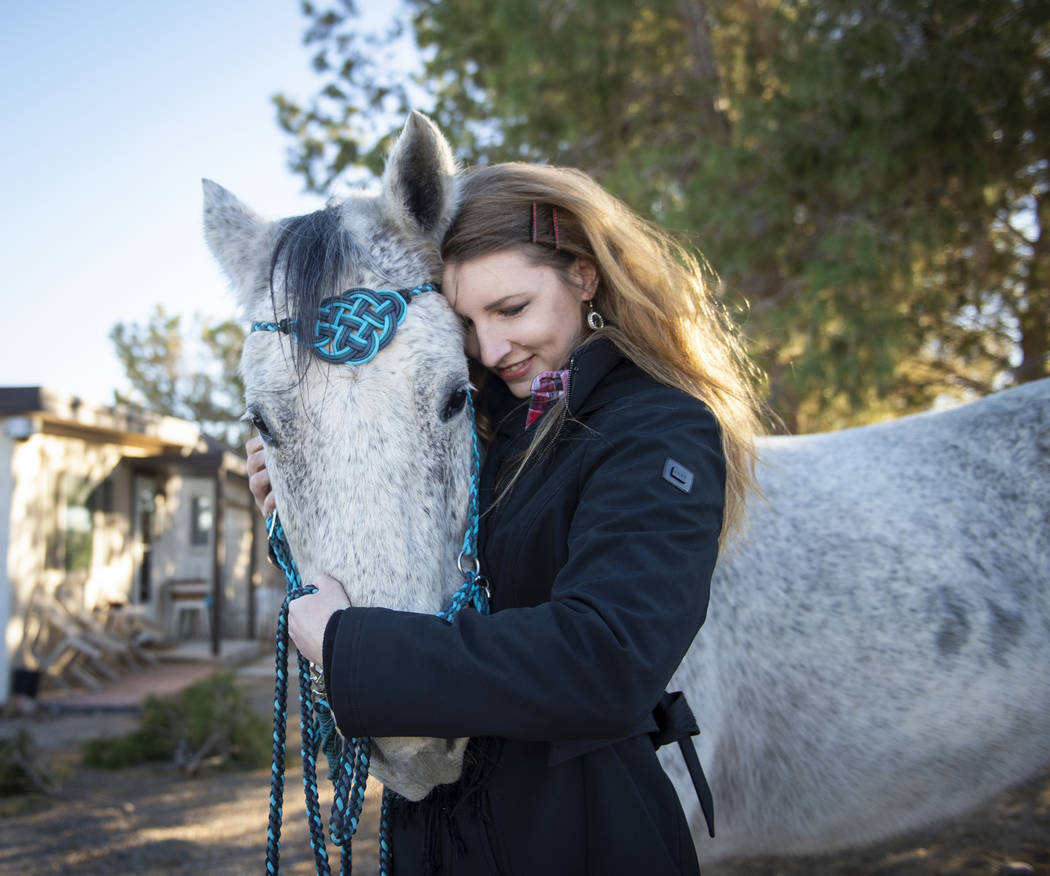 Co-founder Jessie Kuntz poses with J. J., one of the animals on property, at Withers for Warriors in Las Vegas, Monday, Dec. 3, 2018. Caroline Brehman/Las Vegas Review-Journal
