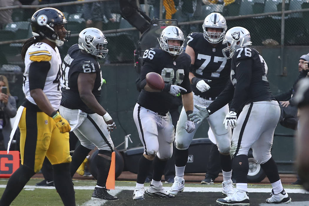 Oakland Raiders tight end Lee Smith (86) celebrates with teammates after scoring against the Pittsburgh Steelers during the second half of an NFL football game in Oakland, Calif., Sunday, Dec. 9, ...