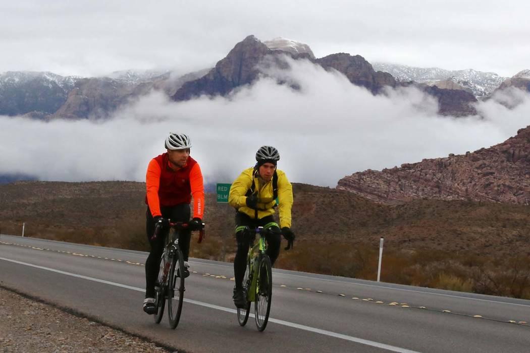 Bicyclists ride their bikes as clouds loom over Red Rock Canyon on Friday, Dec. 7, 2018, in Las Vegas. (Bizuayehu Tesfaye/Las Vegas Review-Journal) @bizutesfaye