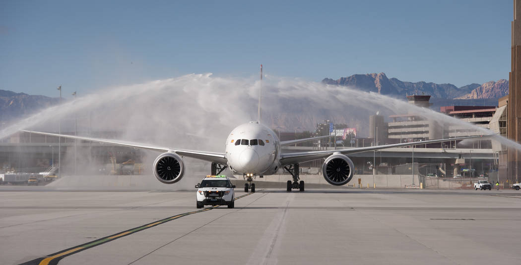 Hainan Airlines flight 7969, a Boeing 787 from Beijing, is greeted with a traditional water arches salute at McCarran International Airport in Las Vegas to inaugurate regular nonstop service from ...