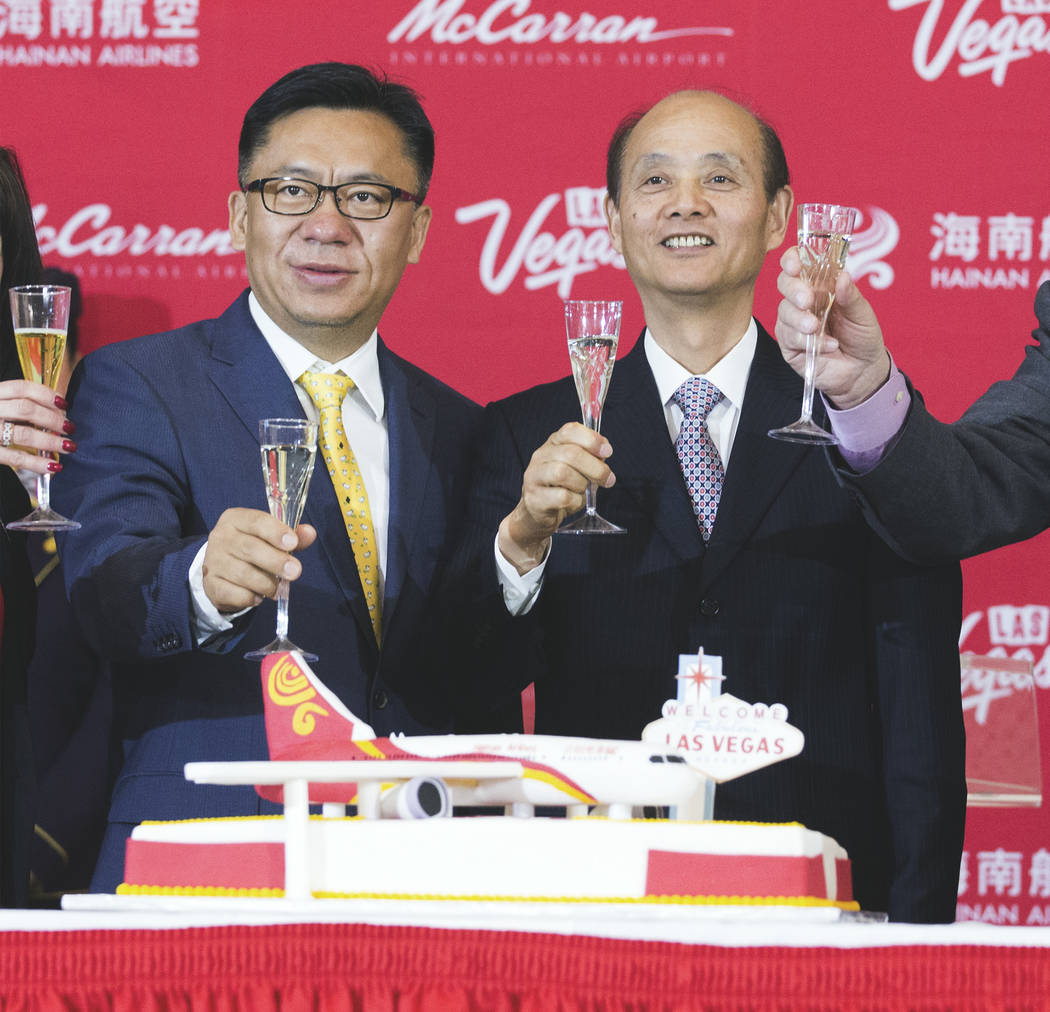 Hou Wei, senior VP of Hainan Airlines, and Luo Linquan, consul general for the Peopleճ Republic of China in San Francisco, toast during a inaugural flight reception at McCarran International ...