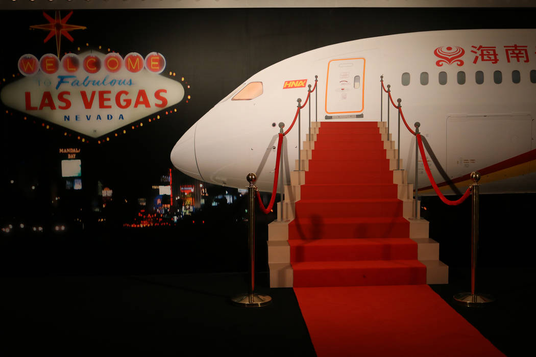 A backdrop of a stairway into a Hainan Airlines plane invites guests to pose for pictures during a launch party for Hainan Airlines' nonstop service from Beijing to Las Vegas. Hainan Airlines and ...