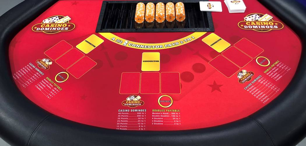 The Casino Dominoes table at the Plaza has six player positions. The table has positions for the connector card and three dominoes cards as well as a place for game wagers and optional doubles bet ...
