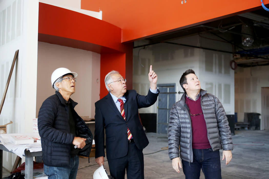 Dave Tanizaki, vice president of design and construction, from left, CEO Moctesuma Esparaza, and Jeremy Welman, COO, discuss plans at the new Maya Cinemas in North Las Vegas, Wednesday, Dec. 12, 2 ...