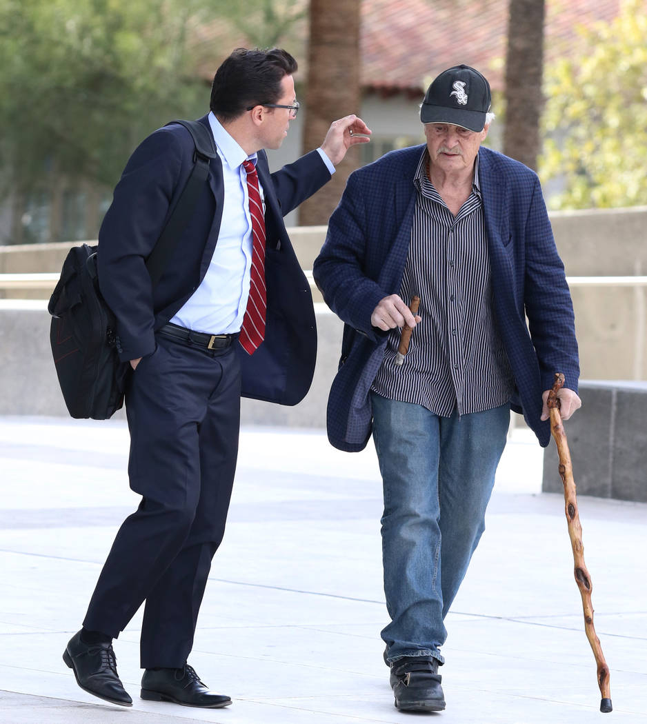 Dr. Steven Holper, right, connected to death of Henderson Justice of the Peace Diana Hampton, arrives at the Lloyd George U.S. Courthouse with his attorney Christopher Frey on Monday, Dec. 10, 201 ...