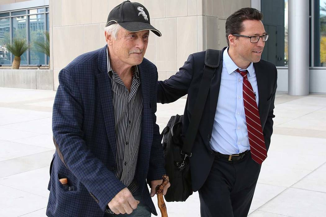 Dr. Steven Holper, left, connected to death of Henderson Justice of the Peace Diana Hampton, arrives at the Lloyd George U.S. Courthouse with his attorney Christopher Frey on Monday, Dec. 10, 2018 ...