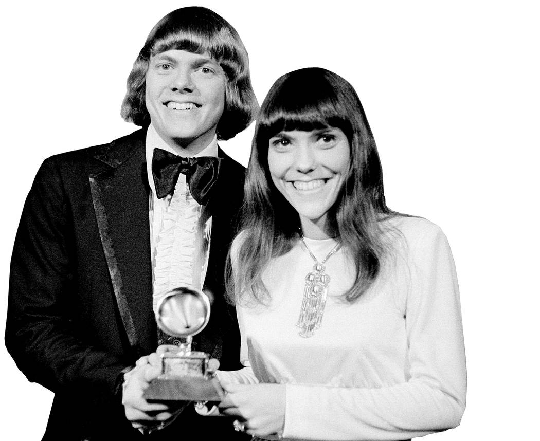 The Carpenters, Richard and Karen, pose with their Grammy during the 13th annual 1970 Grammy Awards in Los Angeles, Ca., March 17, 1971. The brother-sister duo was named best new artist of the ye ...