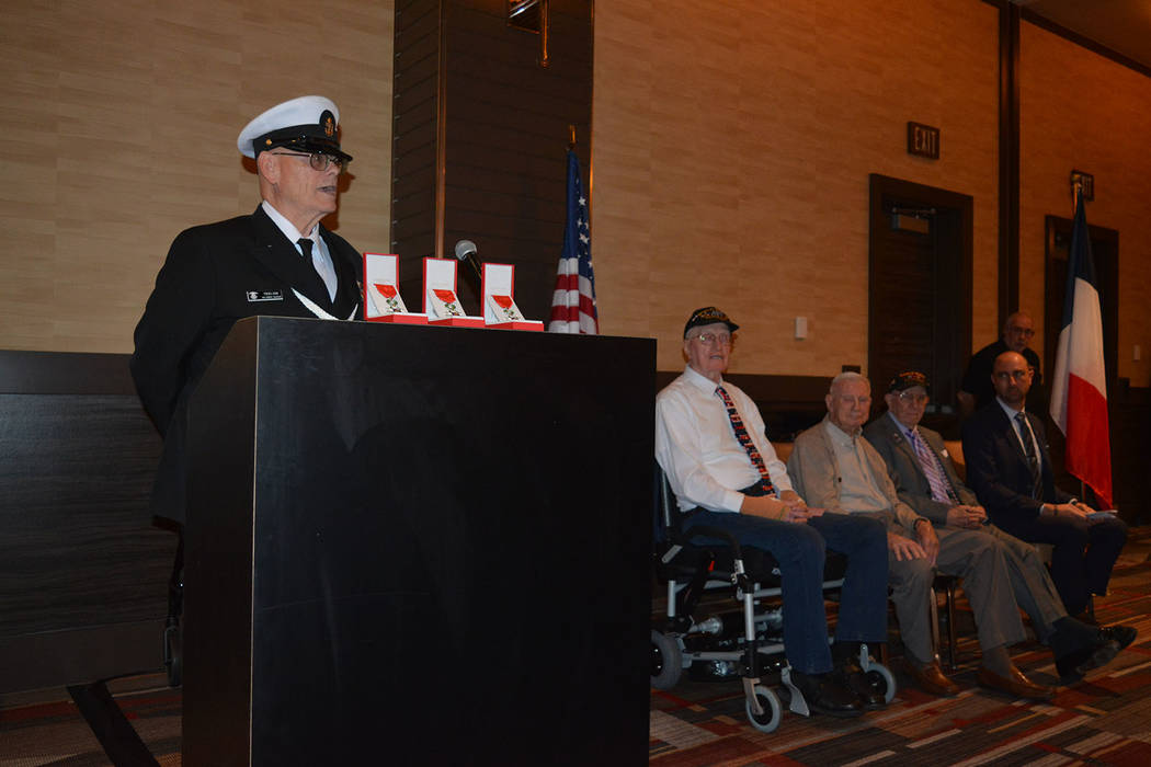 Emcee Andy Truelson speaks at the ceremony. To his left are honorees William Dunsmore, William Kendall and Selwyn Dante, and Sebastien Thevenin, honorary consul of France for Southern Nevada. (Bob ...