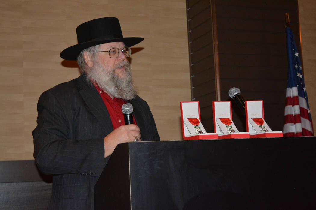 Clark County Museum administrator Mark Hall-Patton speaks Nov. 17 at a presentation honoring three Southern Nevada veterans of World War II. (Bob Reed)