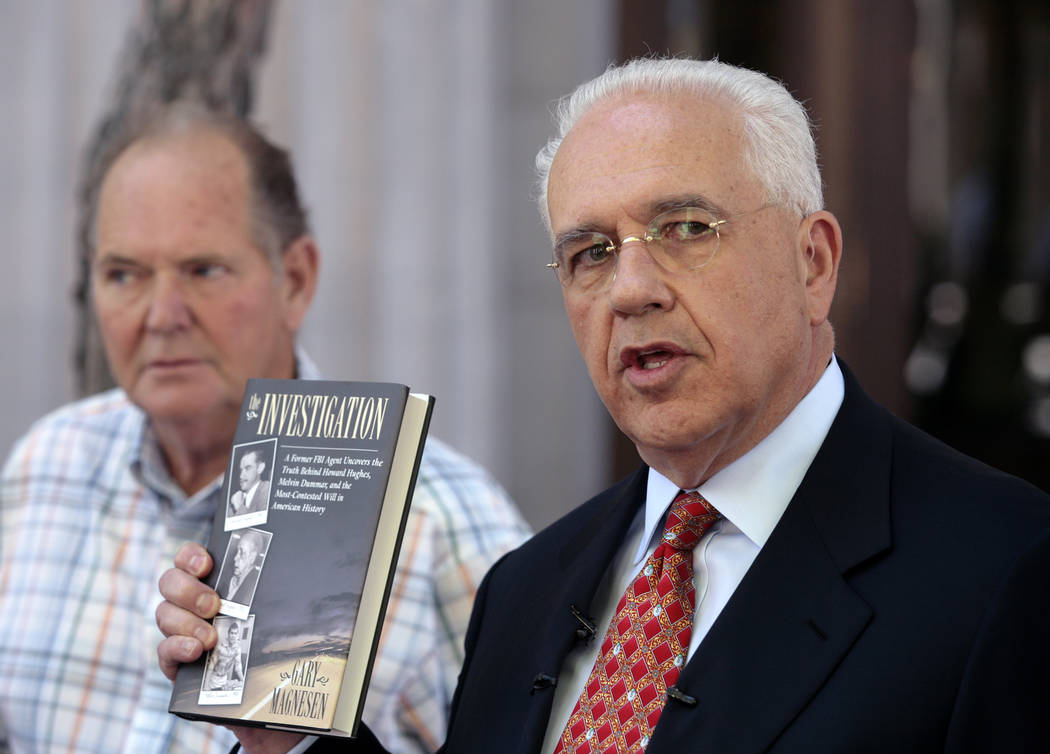 Melvin Dummar, left, and his attorney, Stuart Stein, right, hold a news conference Tuesday, June 13, 2006, in Salt Lake City, while showing a book they say supports Dummar's claim that he helped r ...