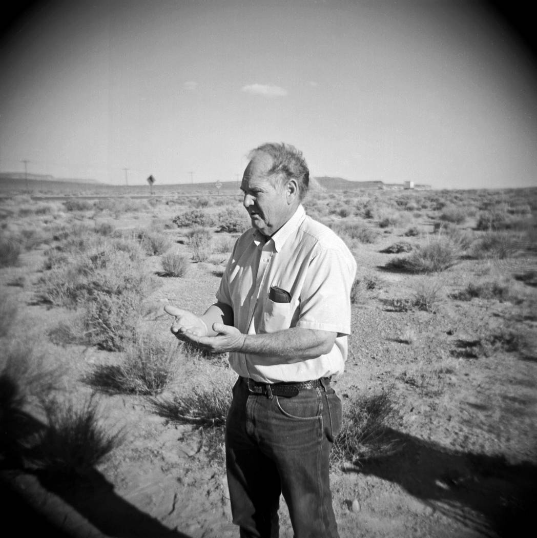 Melvin Dummar stands in the Nevada desert on June 15, 2006 near the location where he claims to have picked up Howard Hughes in 1968. Dummar was at the location along U.S. Highway 95, 160 miles no ...