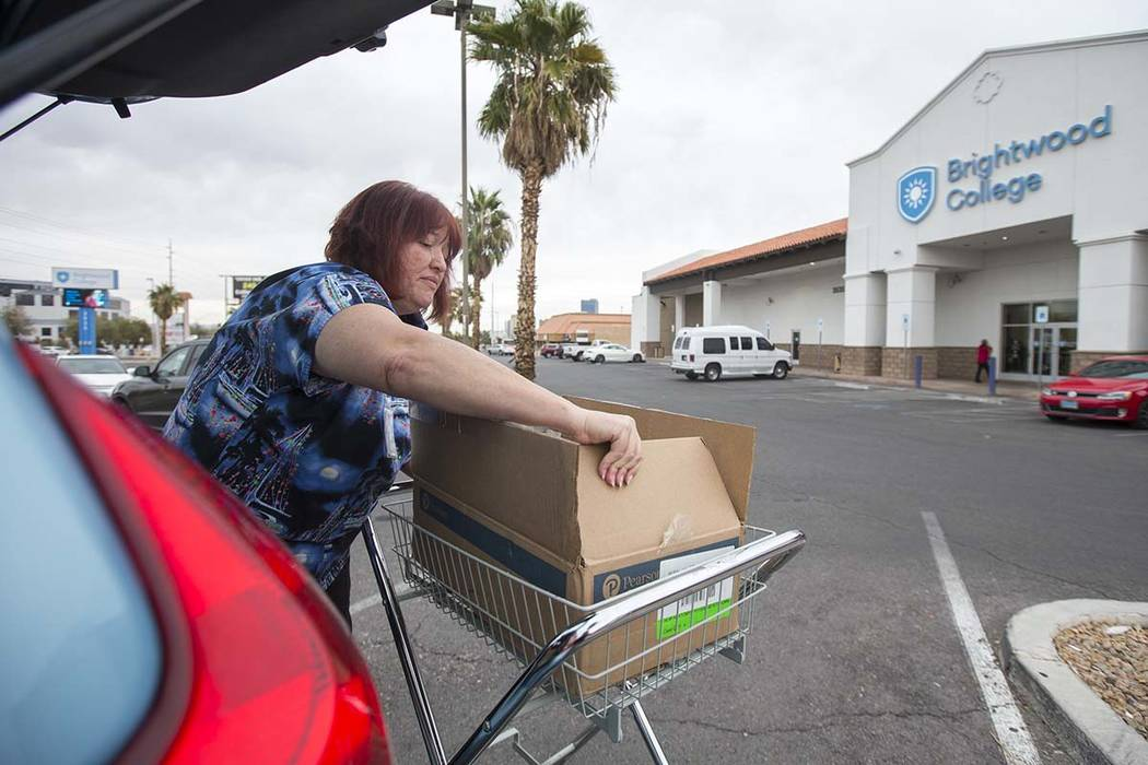 Teresa Summerlin, a registered medical assistant instructor for Brightwood College, packs up some her belongings in the parking lot of Brightwood College located at 3535 W. Sahara Ave. in Las Vega ...