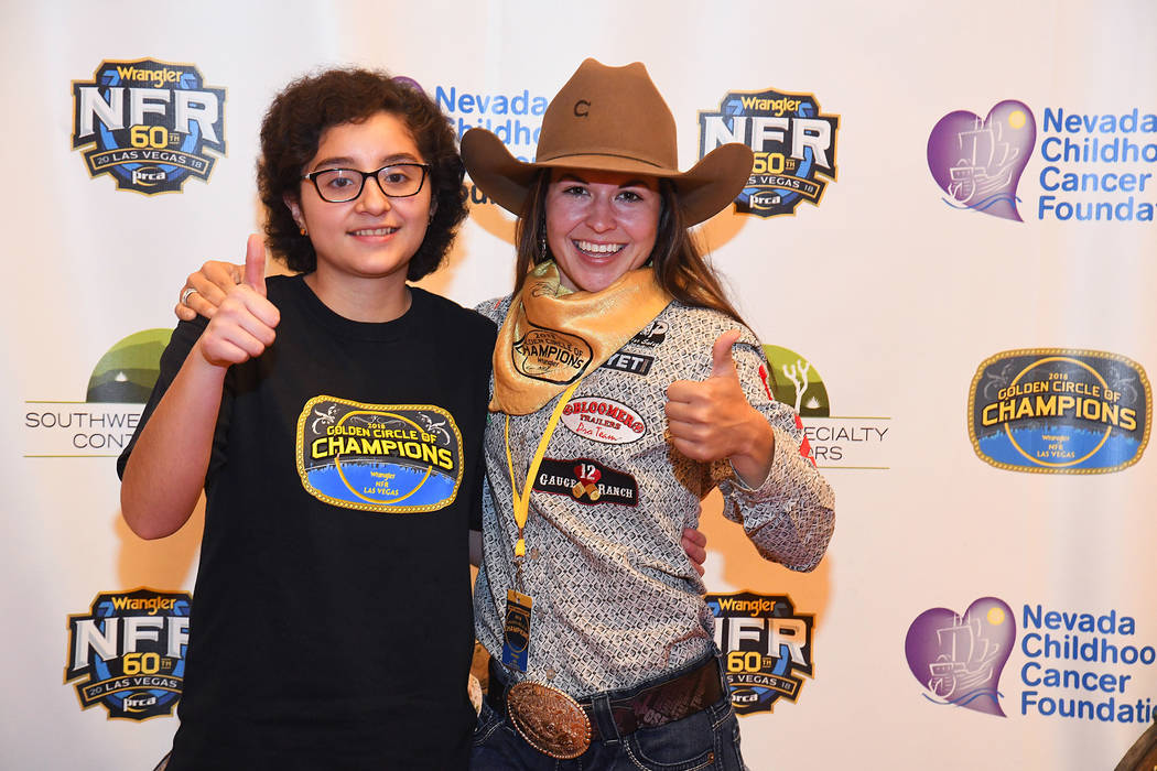Wrangler NFR barrel racer Hailey Kinsel and her new buddy Aileen Say Sanchez of Las Vegas are all smiles during the Golden Circle of Champions Banquet on Sunday at the South Point. The Golden Circ ...