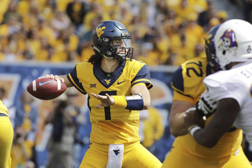 West Virginia quarterback Will Grier (7) attempts a pass during the first half of an NCAA college football game against East Carolina, Saturday, Sept. 9, 2017, in Morgantown, W.Va. (AP Photo/Raymo ...