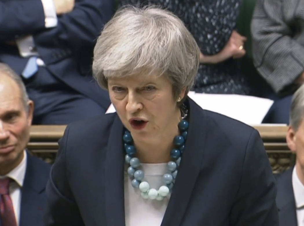 In this image taken from video, Britain's Prime Minister Theresa May makes a statement in the House of Commons, in London, Monday, Dec. 10, 2018. May has postponed Parliament's vote on her Europ ...