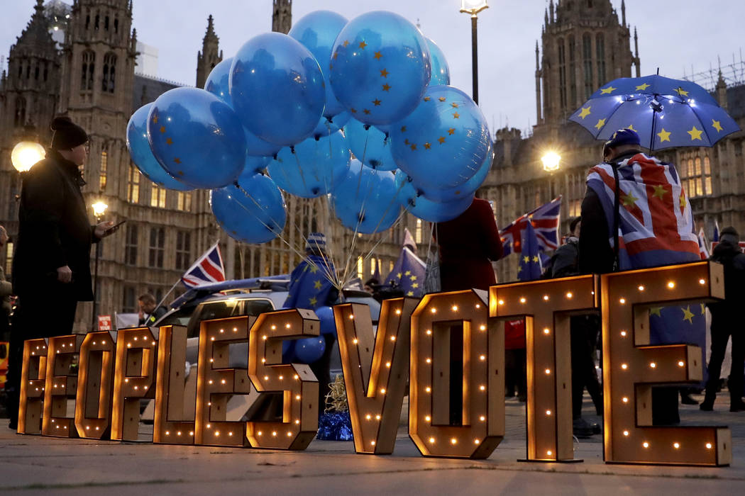 "The words ""Peoples Vote"", which calls for another referendum on Britain's European Union membership, stand lit up after being placed there by anti-Brexit supporters across the street fro ..."