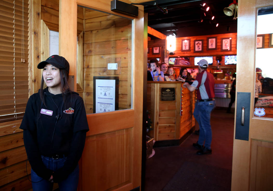 Hostess Nicole Kochensparger welcomes guests to the Texas Roadhouse at 1380 E. Craig Road in North Las Vegas Wednesday, Dec. 12, 2018. K.M. Cannon Las Vegas Review-Journal @KMCannonPhoto