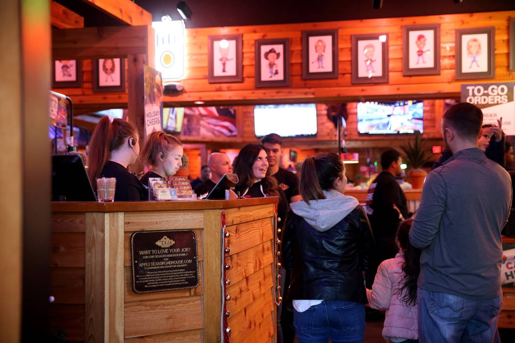 Hostess and hosts welcome guests to the Texas Roadhouse at 1380 E. Craig Road in North Las Vegas Wednesday, Dec. 12, 2018. K.M. Cannon Las Vegas Review-Journal @KMCannonPhoto