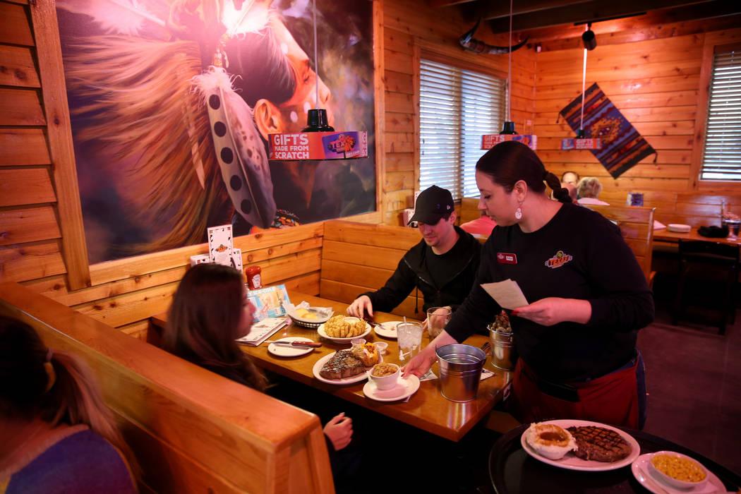 Server Rhea Lantelme delivers dinners to Donna Delavega and Matt Booth of Las Vegas at Texas Roadhouse at 1380 E. Craig Road in North Las Vegas Wednesday, Dec. 12, 2018. K.M. Cannon Las Vegas Revi ...