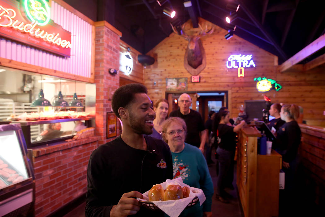 Host Travion King takes guests to their table with fresh baked bread at Texas Roadhouse at 1380 E. Craig Road in North Las Vegas Wednesday, Dec. 12, 2018. K.M. Cannon Las Vegas Review-Journal @KMC ...