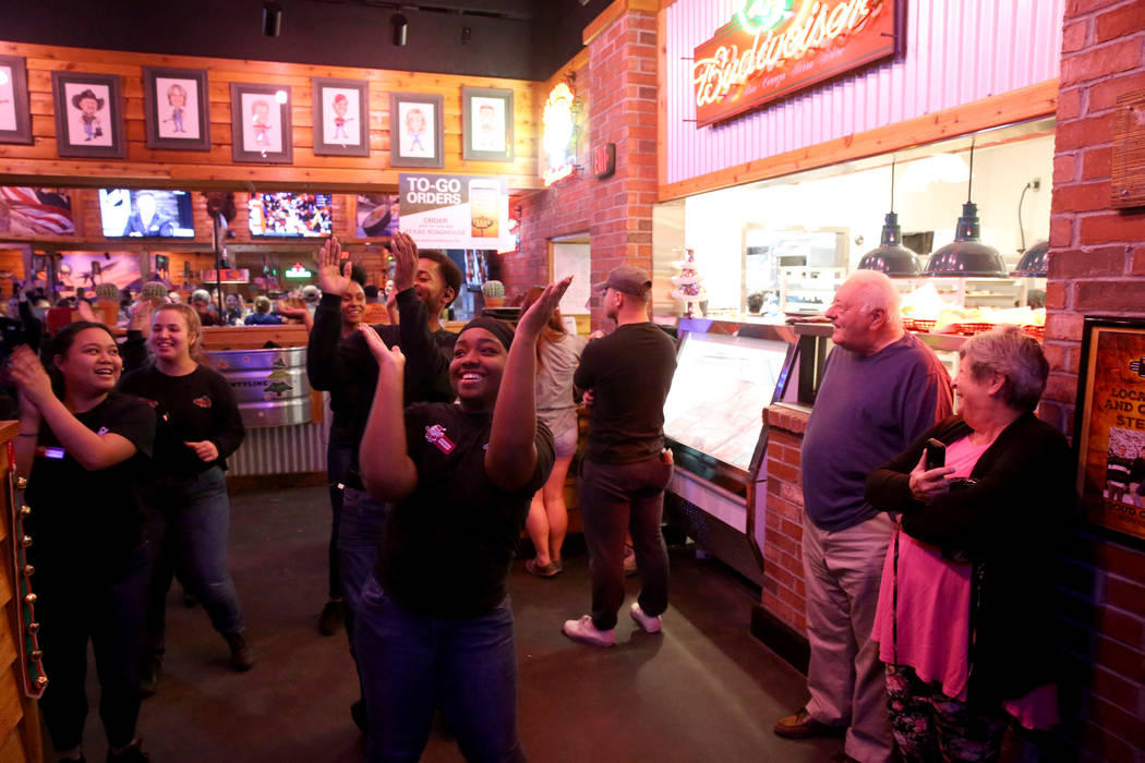 Staff members, including hostess Kemani Williams, dance at Texas Roadhouse at 1380 E. Craig Road in North Las Vegas Wednesday, Dec. 12, 2018. K.M. Cannon Las Vegas Review-Journal @KMCannonPhoto