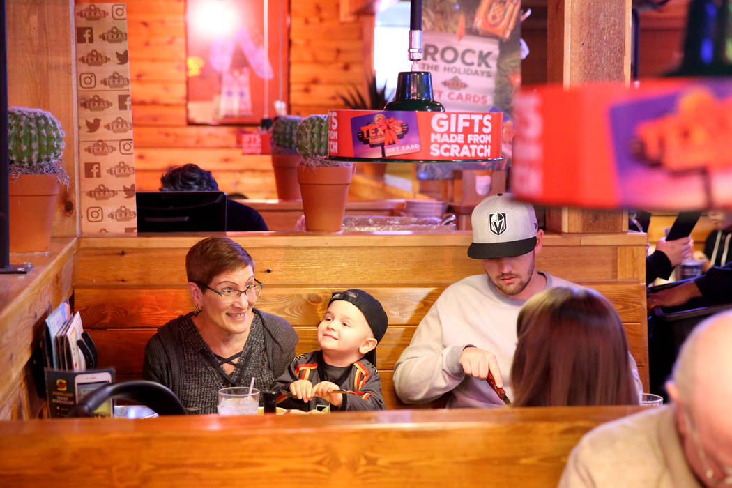 Sue Pinney, left, eats with her son Jacob Pinney, grandson Kassian Pinney, 3, and daughter-in-law Rayna Pinney all of Las Vegas, at Texas Roadhouse at 1380 E. Craig Road in North Las Vegas Wednesd ...