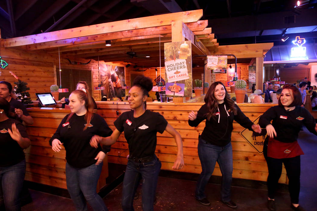Staff members dance at Texas Roadhouse at 1380 E. Craig Road in North Las Vegas Wednesday, Dec. 12, 2018. K.M. Cannon Las Vegas Review-Journal @KMCannonPhoto