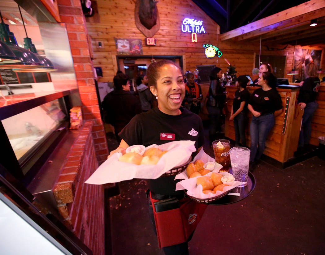 Alecia Grice delivers fresh baked bread and drinks at Texas Roadhouse at 1380 E. Craig Road in North Las Vegas Wednesday, Dec. 12, 2018. K.M. Cannon Las Vegas Review-Journal @KMCannonPhoto